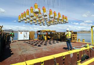 A rig of explosives is lifted by a crane during construction of the the Southern Nevada Water Authority's