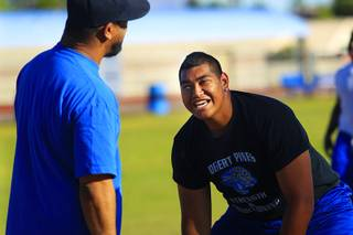 Desert Pines lineman Cedrick Poutasi laughs at one of his coaches during practice Wednesday, May 11, 2011.