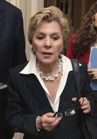 Senate Ethics Committee Chair Sen. Barbara Boxer, D-Calif., is pursued by reporters on Capitol Hill in Washington, Thursday, May 12, 2011, after speaking on the Senate floor about former Nevada Sen. John Ensign.