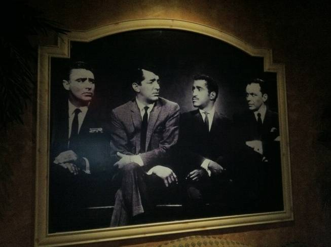 A photo of members of The Rat Pack at the entrance of the House of Lords at Sahara.