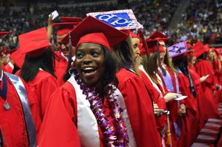 Kendra Jones smiles as she spots her family in the stands during UNLV's spring commencement ceremony Saturday, May 14, 2011 at the Thomas & Mack Center.
