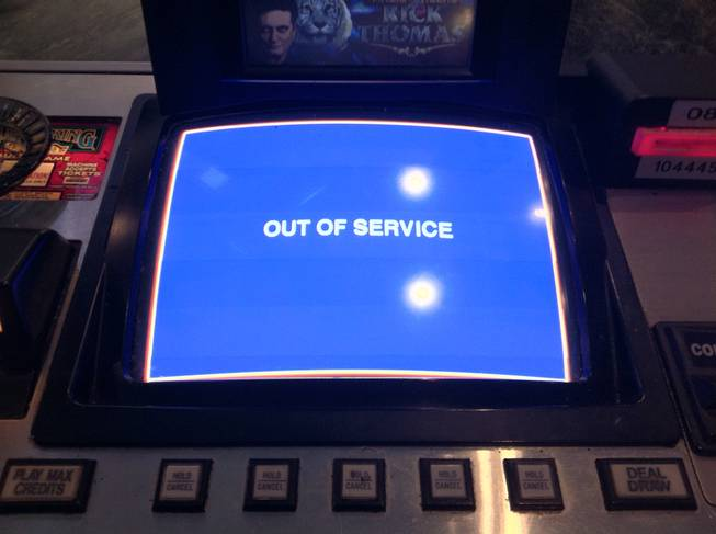 A decommissioned video poker machine at Sahara's Oasis bar tells ...