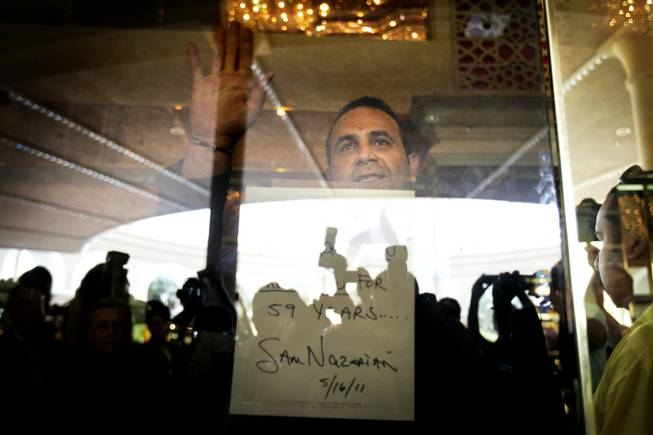 Sam Nazarian, the CEO of SBE Enertainment, the company that owns the Sahara, waves goodbye to the crowd after locking the door to the casino Monday, May 16, 2011.