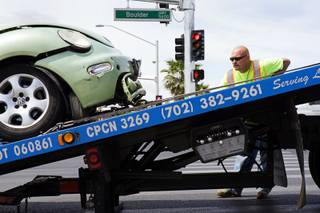 An Ewing Bros. tow operator loads a car onto a tow truck after an accident at Boulder Highway and Tropicana Avenue on Tuesday, May 17, 2011.