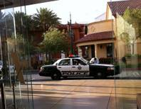 A Metro Police car sits outside the Apple Store at Town Square on Tuesday, May 17, 2011, after, police said, a group of five people entered the store and started stealing iPhones and laptop computers. This photo, ironically, was shot on an iPhone.