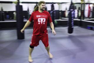 Roy Nelson warms up for a work out as he prepares for his upcoming fight against Frank Mir at UFC 130 Thursday, May 19, 2011.