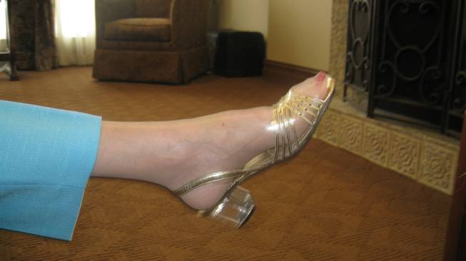 One of Mildred Myers' Annie Shoes, gold in color, high in heel.