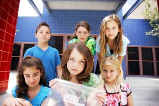 Fifth grader Grant Goodwin, clockwise from top left, second grader Kendall Ruberio, fourth grader Alana Sullivanm first grader Renae Sullivan, fourth grader Gracie Goodwin and kindergartner Kylynn Ruberio gather in front of their school Linda Givens Elementary School in Las Vegas Friday, May 20, 2011. The studenst raised almost $50 running a lemonade stand and have donated the money to their school.