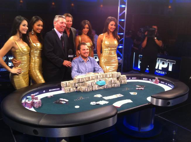 Scott Seiver poses for a photo with the World Poker Tour commentators and hostesses after winning the 2011 World Poker Tour World Championship at Bellagio Friday night. Seiver, a well-known cash game pro, won $1.6 million with the victory.