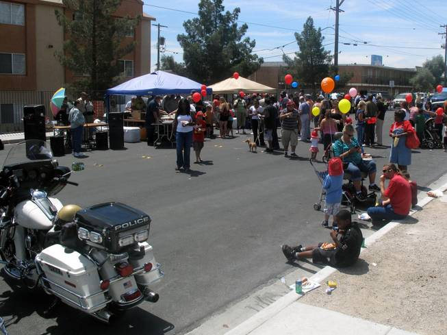 A crowd lines up to get free hot dogs Saturday at a block party sponsored by Metro Police. The block party and safety fair was on 14th Street near Fremont Street in downtown Las Vegas.