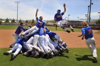 Bishop Gorman players celebrate after beating Green Valley in their championship baseball game Saturday, May 21, 2011. Gorman won 10-0.