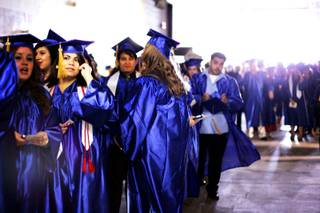 Astrid Silva stands in line, waiting for the commencement ceremony for the College of Southern Nevada at the Thomas & Mack Center in Las Vegas Monday, May 23, 2011.