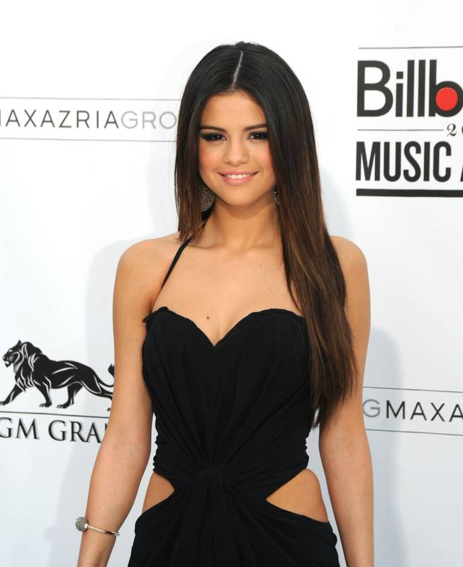 Selena Gomez arrives at the 2011 Billboard Music Awards at MGM Grand Garden Arena on May 22, 2011.