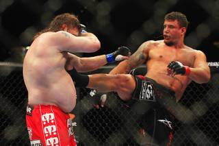 Frank Mir hits Roy Nelson with a kick during their bout at UFC 130 Saturday, May 28, 2011 at the MGM Grand Garden Arena. Mir won by decision.