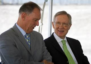 Randy Babbitt, left, Federal Aviation Administration administrator, and Sen. Harry Reid chat before a groundbreaking for a new $99 million FAA air traffic control facility at McCarran International Airport Tuesday, May 31, 2011. The facility is expected to be operational in early 2015.