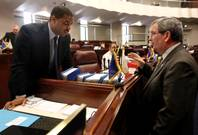 Senate Majority Leader Steven Horsford, D-North Las Vegas, and Minority Leader Mike McGinness, R-Fallon, talk on the Senate floor Monday, May 30, 2011, at the Legislature in Carson City. Lawmakers continue to work with the governor on the state budget, including talks to extend taxes that were set to expire June 30.