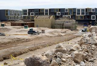 Model homes are shown under construction at a residential development site near Horizon Ridge Parkway and Gibson Road in Henderson Wednesday, June 1, 2011. The defunct Vantage Lofts project is in the background.