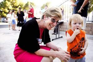 Las Vegas mayoral candidate Chris Giunchigliani says hello to 18-month-old Michael DeBerg during a campaign stop at a downtown barbecue Wednesday, June 1, 2011.
