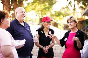 Las Vegas mayoral candidate Chris Giunchigliani, right, talks with supporters Mary Brush, from left, Deray Brush and Mary Joy Alderman during a campaign stop at a downtown barbecue Wednesday, June 1, 2011.