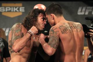 Clay Guida and Anthony Pettis face off during the weigh in for the TUF Season 13 fight card Thursday, June 2, 2011.