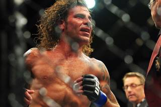 Clay Guida takes a lap around the octagon after defeating Anthony Pettis in their bout at The Ultimate Fighter Season 13 finale Saturday, June 4, 2011.
