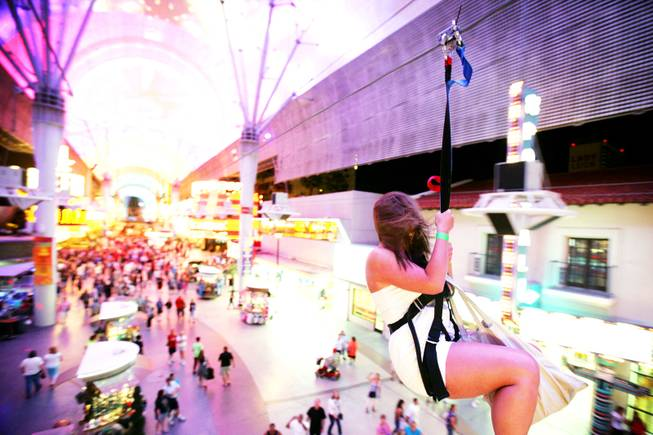 Carolyn Dangel of Pittsburgh rides Flightlinez at the Fremont Street Experience in downtown Las Vegas Monday, June 6, 2011.