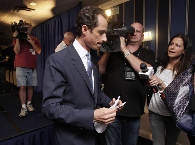 U.S. Rep. Anthony Weiner, D-N.Y., is pursued by the media as he leaves a news conference in New York, Monday, June 6, 2011.