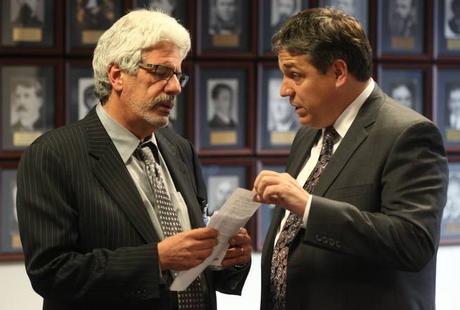 Lobbyist Billy Vassiliadis, left, talks with Nevada Assemblyman Marcus Conklin, D-Las Vegas, on June 6, 2011, at the Legislature in Carson City.
