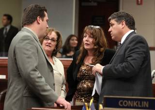 Nevada Assembly Democrats, from left, Speaker John Oceguera, Debbie Smith, Marilyn Kirkpatrick and Marcus Conklin, talk on the Assembly floor Monday, June 6, 2011, at the Legislature in Carson City.