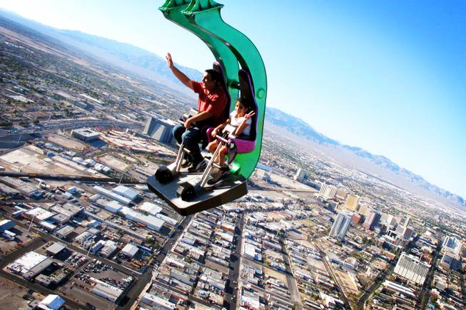 Taahira Bhalla, 9, and her uncle Kapil Rajpad of New Delhi, India, ride Insanity at the top of the Stratosphere in Las Vegas Tuesday, June 7, 2011.