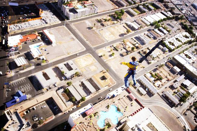 A jumper takes the plunge from SkyJump at the top of the Stratosphere in Las Vegas on Tuesday, June 7, 2011.