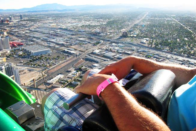 A rider is ready to ride the X-Scream at the top of the Stratosphere in Las Vegas Tuesday, June 7, 2011
