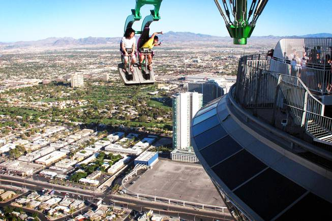 Michael and Jennifer Watkins, of Seattle, ride Insanity at the top of the Stratosphere in Las Vegas on Tuesday, June 7, 2011