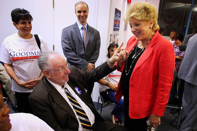 Las Vegas Oscar Goodman points to his wife, mayoral candidate Carolyn Goodman, as early returns show her with a sizable lead during an election night party at her campaign headquarters Tuesday, June 7, 2011.