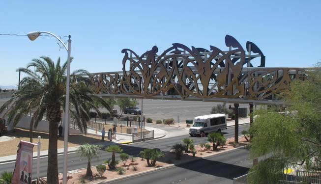 The $1.3 million pedestrian bridge stretches over Las Vegas Boulevard between East Washington Avenue and East Bonanza Road. It is decorated with an LED design created by artist David Griggs inspired by the iconic neon signs of the city's past.
