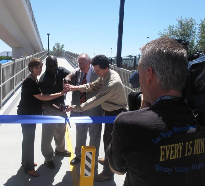 Mayor Oscar Goodman and City Councilman Ricki Barnes help cut the ribbon on the Cultural Corridor Pedestrian Bridge with other project leaders. The bridge will provide more convenient and safe access to several downtown cultural institutions located along Las Vegas Boulevard.