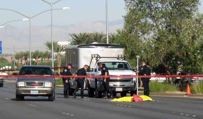 Henderson Police were investigating whether a fatal collision was a suicide Thursday morning on Lake Mead Parkway near Water Street.