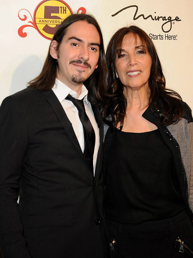 Dhani Harrison and his mother, Olivia Harrison, at the fifth-anniversary celebration of <em>The Beatles Love by Cirque du Soleil</em> at the Mirage on June 8, 2011.