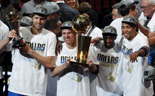 Former Rebel Shawn Marion, far right, celebrates an NBA title with his Dallas Mavericks teammates on Sunday evening in Miami. Marion, who played at UNLV in the 1989-99 season, scored 12 points in the series-clinching 105-95 victory over the Miami Heat. In the process, he became the first UNLV player to win an NBA title since 1972.