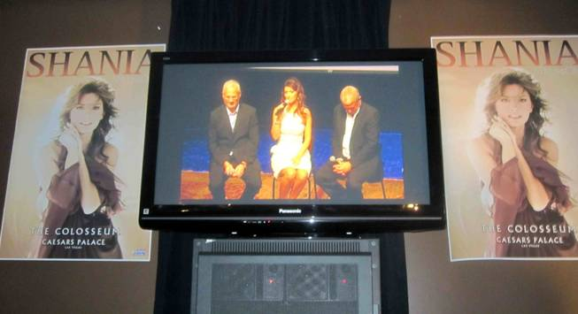 Gary Selesner, Shania Twain and John Meglen appear via satellite from Nashville at Caesars Palace on June 8, 2011.