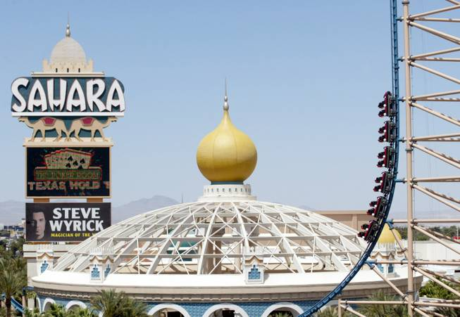 "Passengers head skyward up a 224-foot tower as they enjoy ""Speed-The Ride,"" at the Sahara hotel-casino on May 27, 2002."
