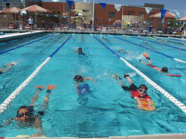 Swimmers paddle their way across the pool at the Henderson Multigenerational Center Tuesday morning. The children were part of an international attempt to set the record for the world's largest swim lesson.