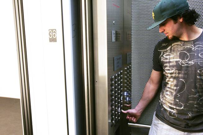 Anthony Young goes up to his apartment at Veer Towers in CityCenter Wednesday, June 15, 2011.