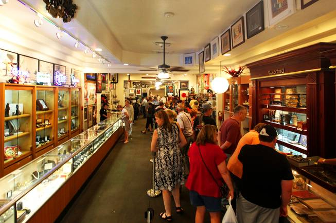 "Visitors browse Gold & Silver Pawn in Las Vegas on Wednesday, June 15, 2011. The shop is the home to the reality TV show ""Pawn Stars"" on The History Channel."