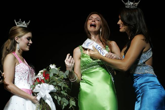 Christina Keegan, center, reacts after winning the 2009 Miss Nevada Pageant while Miss Nevada 2008, Julianna Erdesz, right, and Nevada's Outstanding Teen 2009, Alexis Hilts, left, congratulate her at the Pioneer Center for the Performing arts in Reno, NV, Saturday, June 27, 2009.