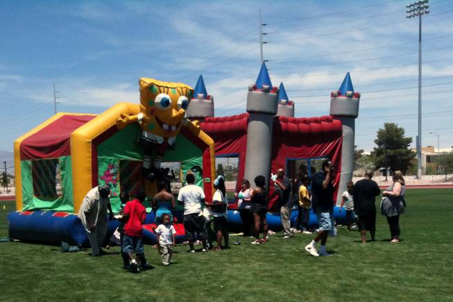 Children -- and some dads -- take advantage of the bounce houses at the Southern Nevada Regional Housing Authority's Father's Day celebration Saturday at the Pearson Community Center.