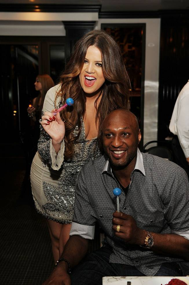 Lamar Odom and Khloe Kardashian Odom at Sugar Factory American Brasserie at the Paris on June 17, 2011.