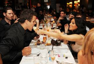 Kris Humphries and Kim Kardashian at Sugar Factory American Brasserie at the Paris on June 17, 2011.