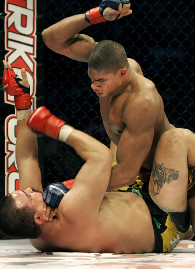 Alistair Overeem, top, punches Paul Buentello in a 2007 Strikeforce heavyweight title fight. Overeem is one of four fighters remaining in the Strikeforce heavyweight tournament.