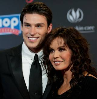 Adam Gregory and Marie Osmond at the 38th Annual Daytime Emmy Awards at the Las Vegas Hilton on June 19, 2011.